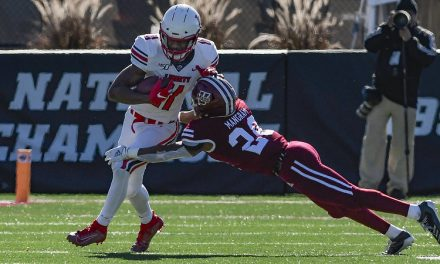 Liberty moves within one game of bowl eligibility with rout of UMass